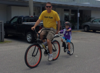 Tandem bike attachment from Fun and More Rentals